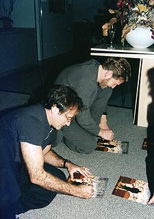 Robin Williams and Kenneth Branagh signing autographs
