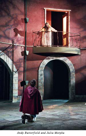 Juliet on her balcony, Romeo kneels