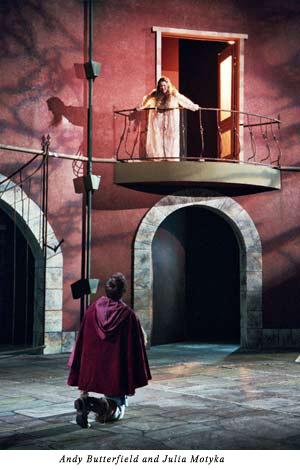 Juliet on her balcony, Romeo kneels