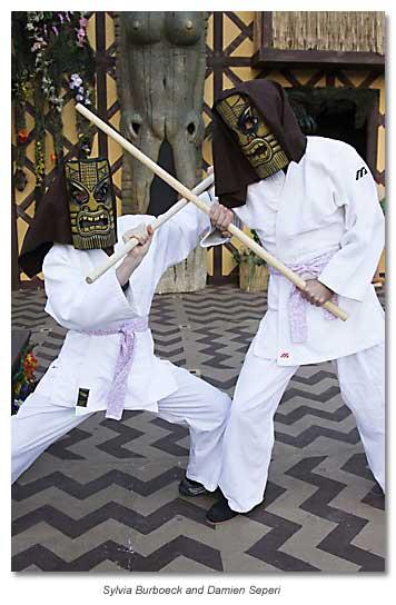Hippolyta and Theseus fight with jo sticks